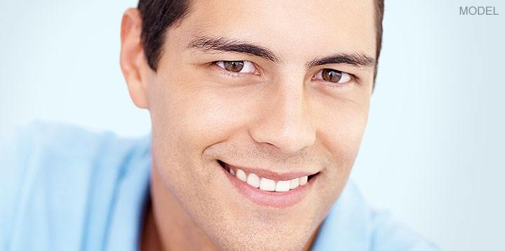 Male rhinoplasty model smiling