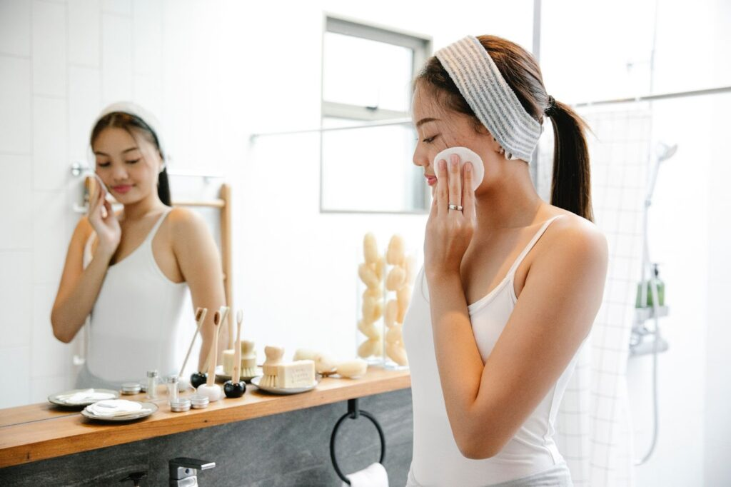 Women taking off her makeup in the bathroom